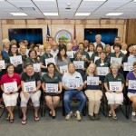 Pictured below are numerous senior volunteers who participate in various programs with Kaunoa Senior Center's RSVP program and seniors from the Maui DHS Foster Grandparent and Senior Companion Programs. Included in the foreground are Maui County Managing Director Keith Regan, Supervisor of Kaunoa Senior Center's RSVP program Dana Acosta, Maui DHS Adult and Community Services Administrator Scott Seto.