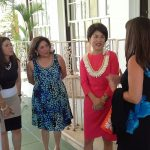 Conference attendees converse with First Lady Dawn Amano-Ige.