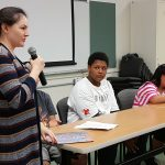 Youth panelists share their thoughts with attendees at the fair.