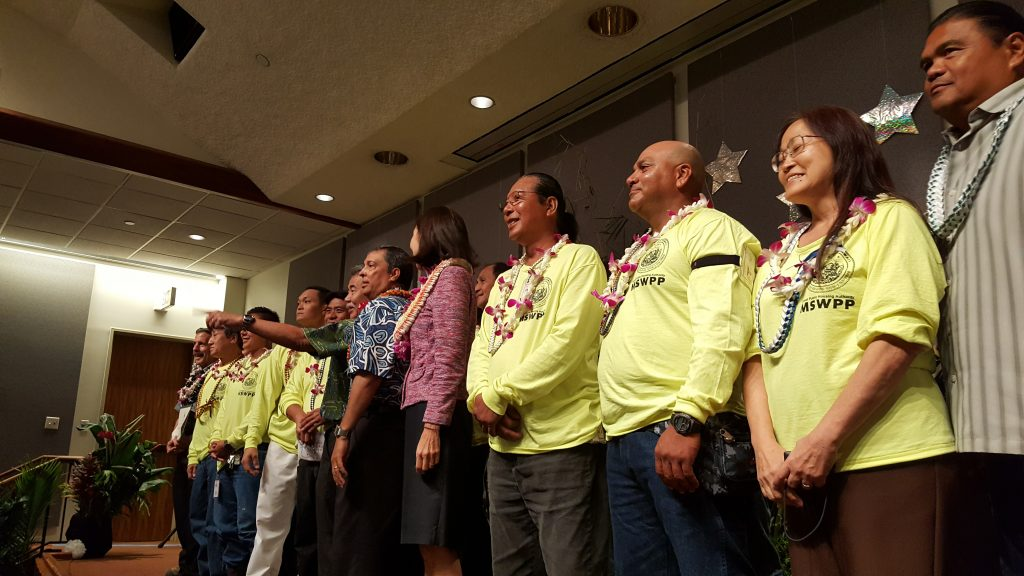 the Multi-skilled Worker Pilot Program in the Hawaii Public Housing Authority accepts the honor as team of the year.