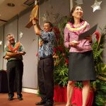Gov. David Ige, DHS Dir. Pankaj Bhanot and DHS Deputy Dir. Bridget Holthus ready to announce the employee of the year.
