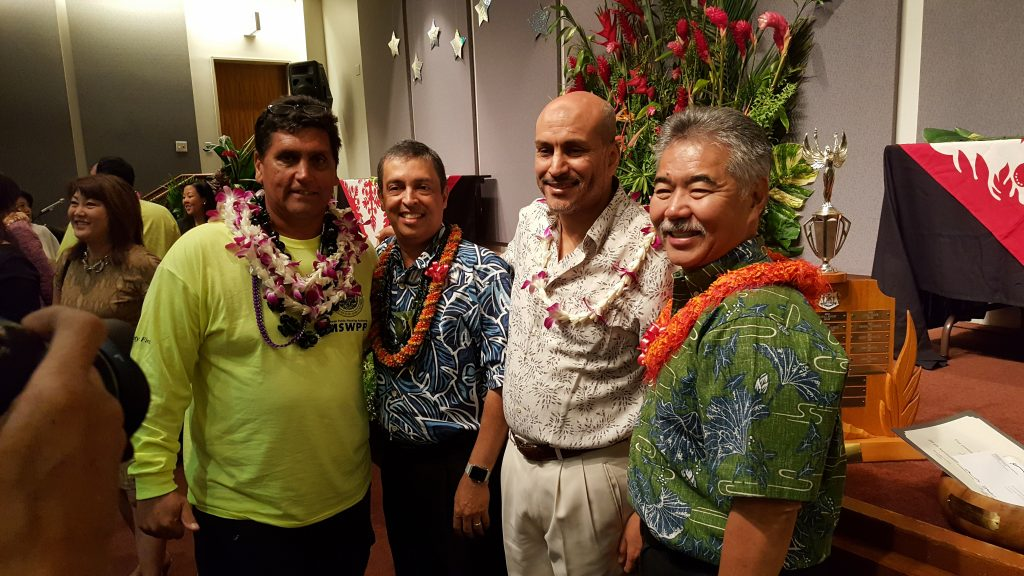 Andrews Medeiros of Hawaii Public Housing Authority poses with Dir. Bhanot, HPHA executive director Hakim Ouansafi, and Gov. Ige.