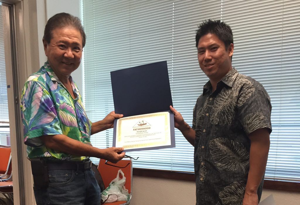 Commission on Fatherhood Chair Carl Makino (left) honors logo designer Jonathan Zane for his work.